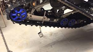 how to adjust track tension on a snowmobile youtube