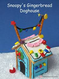 brown christmas snoopy dog house snoopy s gingerbread doghouse party pinching