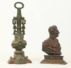 a cast iron duke of wellington door stop and another decorative