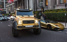 Gold Plated Mercedes Bentley And Lamborghini Flown To London By