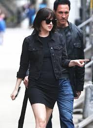 dakota johnson in a denim jacket celebrities in designer jeans