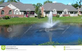 homes around a landscaped pond royalty free stock photos image