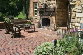 natural elegant garden wall fireplace outside that has brick with