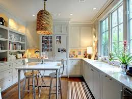 traditional kitchen with breakfast bar built in bookshelf traditional kitchen with wine refrigerator flat panel cabinets pendant light built in