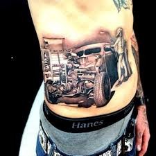 picture of car repair shop tattoo on the whole back