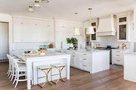 what color to paint kitchen island with white cabinets white dual kitchen islands painted sherwin williams