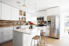 White Kitchen Cabinets With Black Island by Kitchen Duo Tone Kitchen With Marble Countertops Also Black