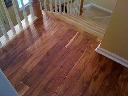 photo of installing hardwood flooring on stairs installing