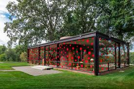 artist yayoi kusama bedecks the glass house with speckles