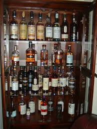 Glass Door Bar Cabinet Brown Wooden Liquor Cabinet Having Glass Board Shelves Also