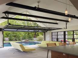 exterior folding doors pool house with garage door luxury pool