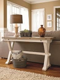 Plain Wooden Sofa Designs White Sofa Table White Wall Dark Floors And Dark Beams With