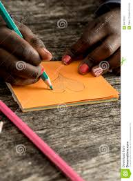 heart shaped writing paper closeup of african american girl drawing and coloring a heart sh closeup of african american girl drawing and coloring a heart sh stock illustration