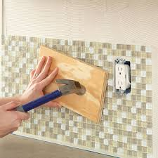 installing backsplash tile in kitchen install a kitchen glass tile backsplash