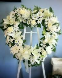 flower for funeral heart shaped easel spray with lilies roses daisies funeral