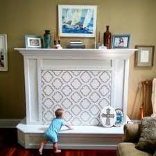baby proof the fireplace hearth with a padded bench future home