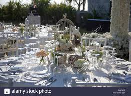 wedding reception decoration table chair trees eating plates