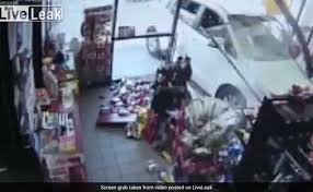 on cctv car crashes into store nearly crushes man to death