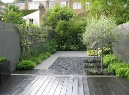 Backyard Pebble Gravel Modern Landscape And Yard With Raised Beds By Lukas Machnik
