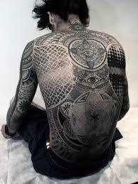 amazing black one eyed eastern mandala design tattoo male full