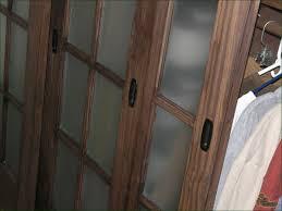 Bifold Barn Door Hardware by Simple Bedroom With Rustic Sliding Barn Door Hardware Dark Brown