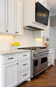 lovely kitchen features ivory cabinets adorned with oil rubbed