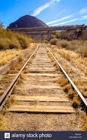 California Vegetaion images Train tracks in the desert with dry vegetaion growing between the jpg