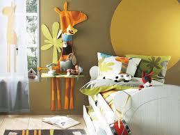 yellow mustard kids bedroom paint color with giraffe wall art