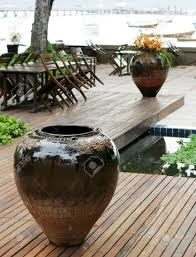 ceramic pot at an outdoor seating area of a restaurant by the