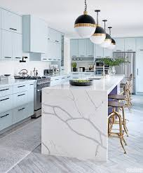 are blue cabinets trendy icy blue cabinetry and a marble look island give this