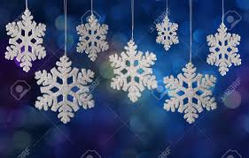 christmas snowflake ornament on a holiday lights background stock