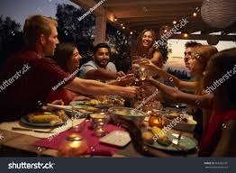 friends make toast dinner party on stock photo 562283791