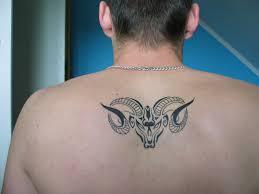 tribal aries zodiac tattoo on upperback tatoos 3