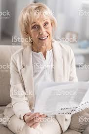 elegant mature woman elegant mature woman holding newspaper stock photo more pictures