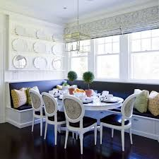 white blue banquette built in storage white dining table black