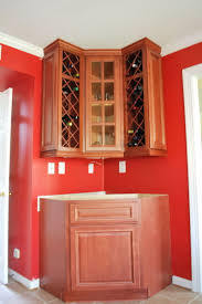 decorating above kitchen cabinets wine theme home design ideas