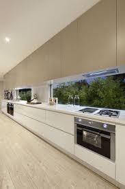 harvey jones linear kitchen with red glass splashback like the