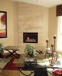 floor to ceiling travertine fireplace that creates a dramatic focal point home interior