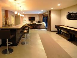 Finished Basement Contractors by Basement Dining Set And Sectional Sofa With Area Rug Also Wood