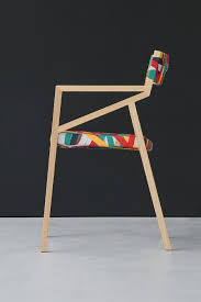 Multi Coloured Chairs by Trendy Minimalist Wood Chair Wrapped In Multicolored Suspender Magic