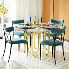 20 high end dining tables for stylish homes view in gallery carrara marble and brass dining table from jonathan adler