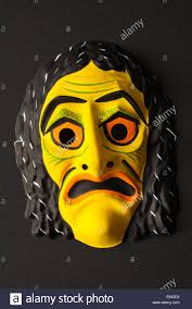 scary halloween mask isolated on black background stock photo