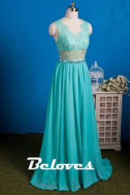 mint green chiffon prom dress with open back and lace bodice