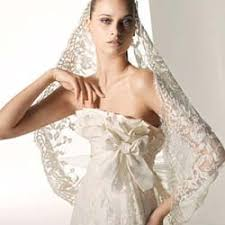 mantilla veil with lace dress bring some spanish into your wedding