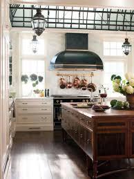kitchen style chandeliers wood countertop brown wood range hood