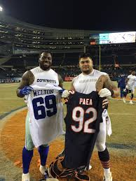 dallas cowboys thanksgiving jersey henry melton and stephen paea swapping jerseys after the game