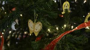 close up of gold butterfly decorations on a christmas tree stock