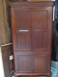 cherry wood corner cabinet clever corner linen cabinet for space saving bathroom idea