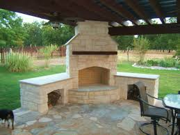 Outdoor Fireplace Chimney Height by Outside Kitchen With Grill And Stone Corner Fireplace Under The