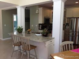 cute white shaker kitchen with an island with barstool seating cute white shaker kitchen with an island with barstool seating glass cabinets and crown molding